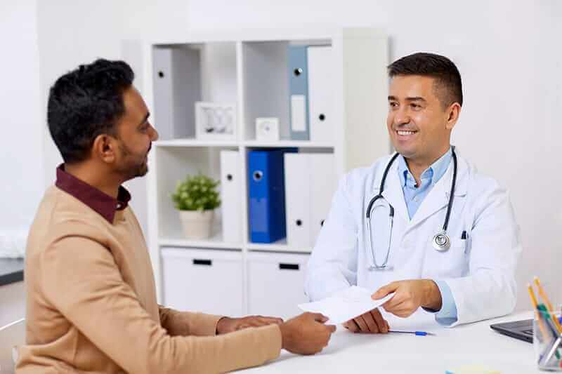 Doctor welcoming client to Orange County IOP program